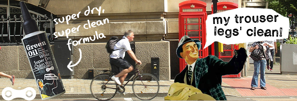 Cyclist in London riding past telephone box